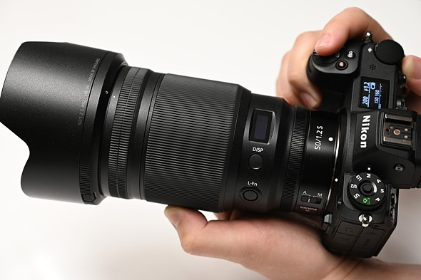 Why are modern 50mm lenses so damned complicated?